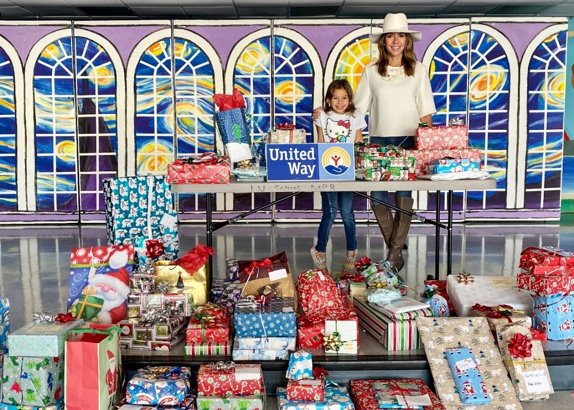 Seasons of Giving Event Chair, Shari Liu, and her daughter help  distribute over 500 gifts to children and families in need.